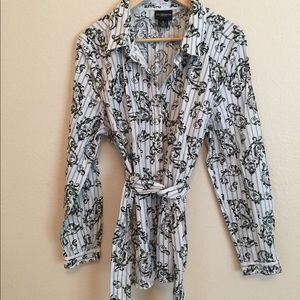 Women's button down top with tie back.